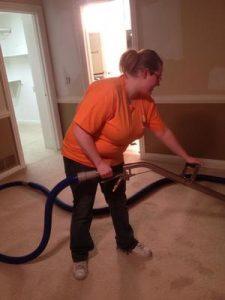 Water Damage Platte City Technician Vacuuming Up Water