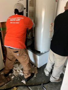 water-damage-restoration-water-heater-wall