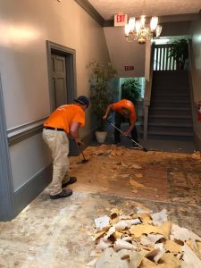 Technicians Cleaning Up Water Damage In A Residential Property
