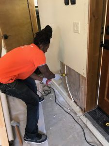 A Technician Making Flood Damage Repairs