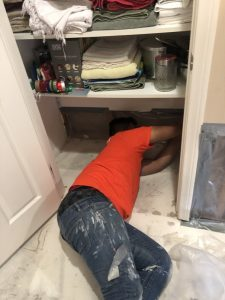 A Technician Working in a Home with Flood Damage